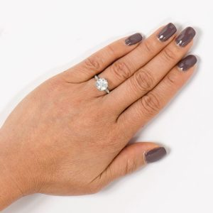 3 carat engagement ring on a finger